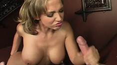 Nikki Sexx bares her tits and rubs her clit as she blows a dick