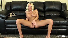 Riley Evans spreads her legs to give the camera a better look