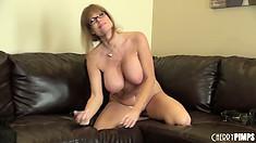 Busty cougar with a hot secretary look masturbates on camera