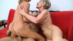 Two naughty ladies take turns fucking a young guy's dick on the couch