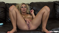 Mikayla spreads her body all over the sofa and drills her snatch with a blue dildo