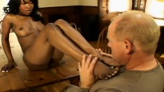 Ebony babe Stacey Cash gets her feet and cunny licked before she blows him