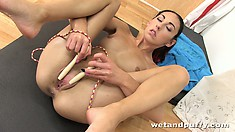 She plays with the jump rope, gets naked and sticks out ass to finger twat