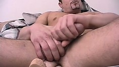 Handsome stud with a thick cock gets some help while jacking it