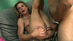 The hot blonde spreads her lovely legs and allows that big cock deep in her snatch