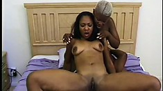 Two enticing ebony girls seduce a black stud and take turns fucking his huge dick