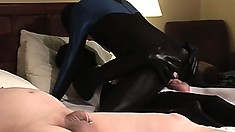 He lays there naked while two latex covered twinks fuck next to him