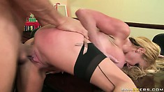 He jams his throbbing prick into her shaved cunt and pounds her
