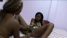 Black babes Deja Vu and Jennifer Jones get naughty and fuck with toys