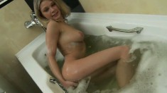 Perky blonde model shows every inch of her curvy body in the bath