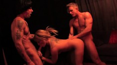 Pretty blonde chokes on two cocks and has them filling her tight holes