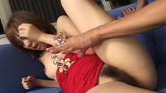 Little Japanese girl chomps on his prick before he pumps her cunt