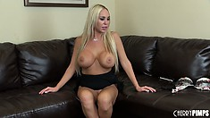 She sits up and poses her hot body, shows her cunt and big tits