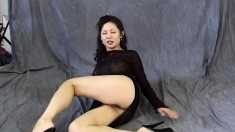 Asian hottie in a sexy black dress Maya Chung performs for the camera