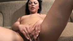 Dark-haired sex goddess takes her clothes off and plays with herself