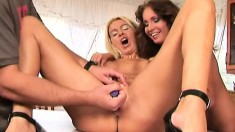 Tight-bodied blonde moans while taking in her hot friend's fist