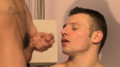 Skinny young dude gets down on his knees to work a bunch of boners