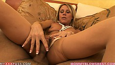 The blonde lady gets on her knees and puts on display her amazing blowjob skills